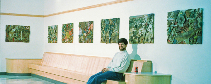 Image of artist, Michael Anderson, in front of one of his mural installations.
